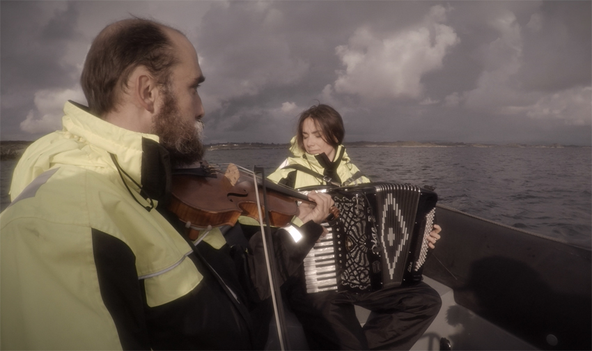 Lisa and Hal playing in Norway to attract KillerWhales... They are known to love Accordeon!